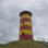 Dichte Wolkendecke über dem Pilsumer Leuchtturm.