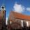 Im Rheiderland sehen die Kirchtürme aus wie Leuchttürme, wie hier in Ditzum.