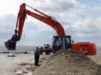 Bagger im Sand
